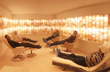 People relaxing in a salt cave