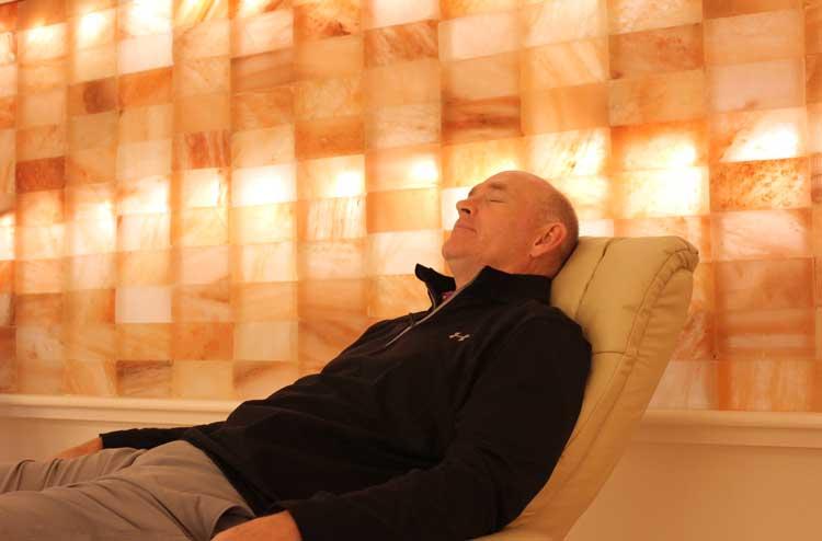 man asleep in a chair