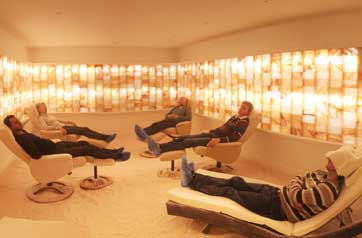 people lying on loungers in a room